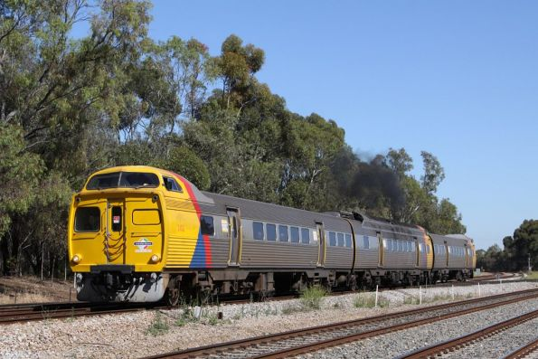 Jumbo 2102 in Adelaide Metro livery leads a 3-car set at Torrens Junction, with a bit of smoke from the exhaust