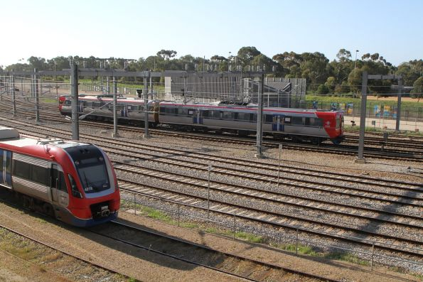 A-City 4018 stabled outside Adelaide station, as 3106 passes by