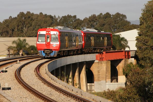 3020 and 3023 arrive into Port Adelaide on a down Outer Harbor service
