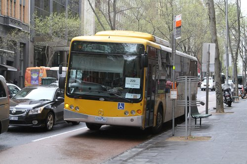 Mitchell Transit bus #9 0709AO heads south on route 220 at Queen and Collins Street