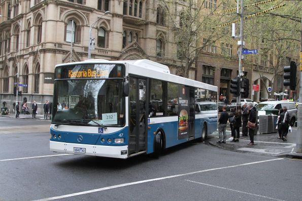 Kastoria bus #47 6843AO on route 232 turns from Collins into Queen Street