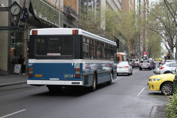 Kastoria high floor bus #9 BS01EG on route 232 turns from Collins into Queen Street