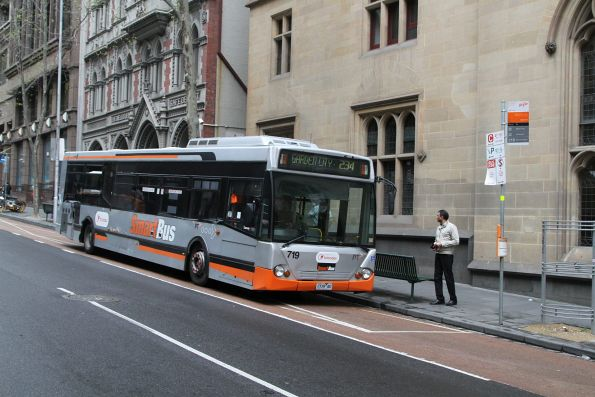 Transdev bus #719 1719AO heads south on route 234 at Queen and Collins Street