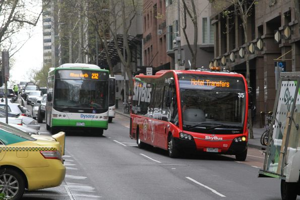 Dysons bus #718 8395AO heads south on route 219 at Queen and Collins Street