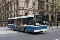 Kastoria bus #16 1416AO heads north on route 220 at Queen and Collins Street