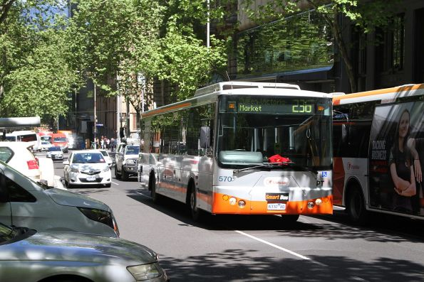 Smartbus liveried Transdev bus #570 6332AO heads north on route 236 at Queen and Collins Street