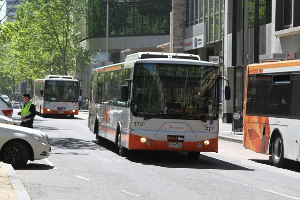 Smartbus liveried Transdev bus #570 6332AO heads south on route 235 at Queen and Bourke Street