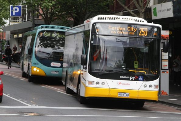 Transdev buses 9103AO and 7291AO westbound at La Trobe and Swanston Streets