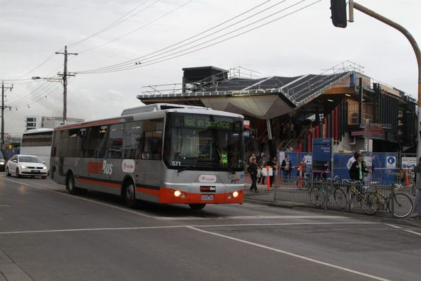 Transdev bus #571 rego 6335AO heads past Footscray station, bound for the Footscray depot