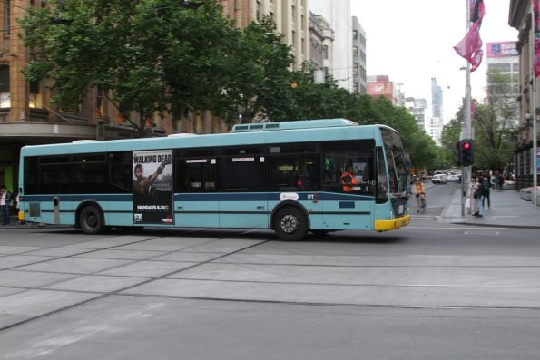 Out of service Transdev bus #757 passes the corner of Collins and Swanston Streets