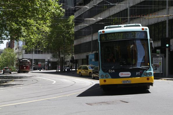 Transdev #534 rego 5830AO on route 237 turns from Flinders Lane into Market Street