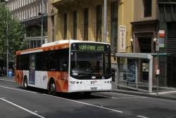 PTV liveried Transdev bus #424 rego 7824AO northbound on route 220 at Queen and Bourke Street