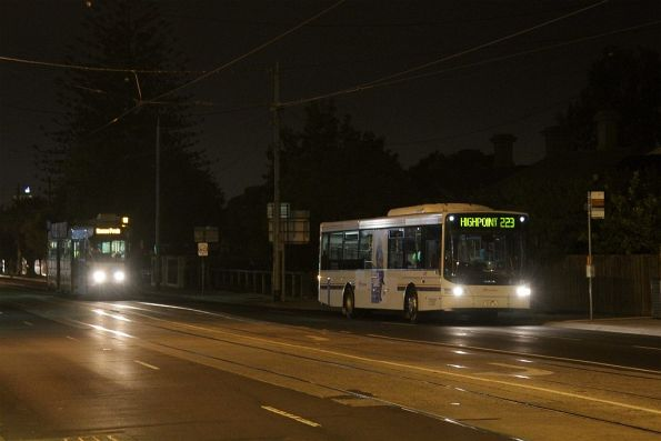 Transdev bus on route 223 along Ballarat Road  drops off passengers at Gordon Street