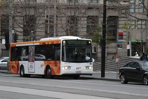Transdev bus #371 rego 0371AO on route 235 picks up passengers outside Southern Cross Station