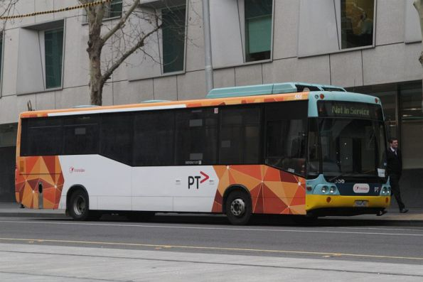 Transdev bus #556 rego 5944AO with the PTV livery partially applied