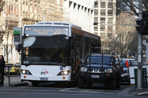 Transdev bus #977 rego 8258AO on route 237 stuck in traffic at Collins and William Streets