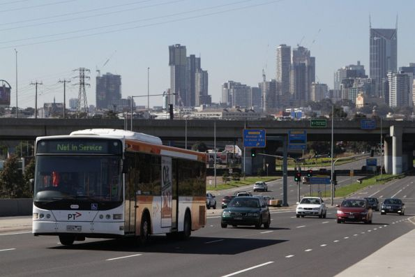 Transdev bus #439 rego 9039AO heads west on Footscray Road towards the depot at Footscray