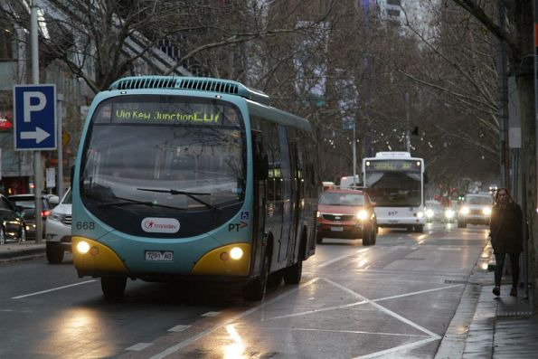 Transdev bus #668 rego 7291AO on route 207 heads west along Lonsdale Street