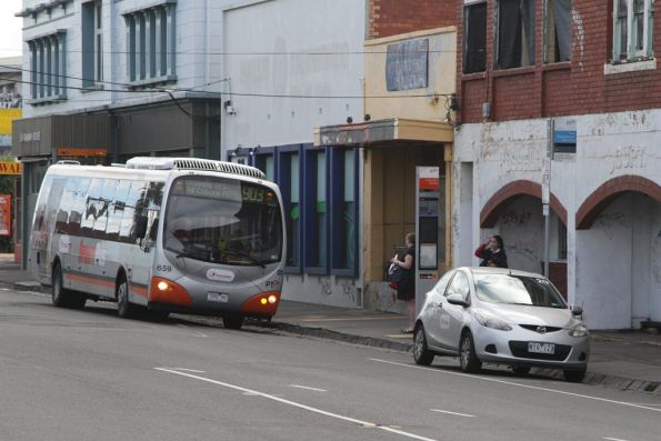 Transdev bus #659 rego 7282AO picks up Altona-bound route 903 passengers at Essendon station