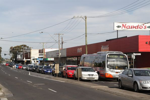 Transdev bus #637 rego 7260AO heads west on a route 903 service along Bell Street in Coburg