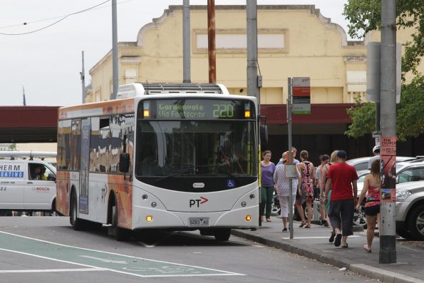 Transdev bus #383 rego 5283AO on a southbound route 220 service stops at Queen Victoria Market