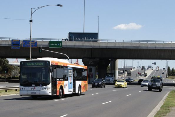 Transdev bus #438 9038AO heads out of service along Footscray Road