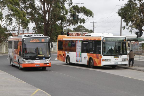 Transdev bus #8614 rego 7980AO and Ventura bus #141 rego 0492AO at Dandenong station