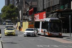 Transdev bus #683 rego 7973AO does a u-turn at the west end of Lonsdale Street