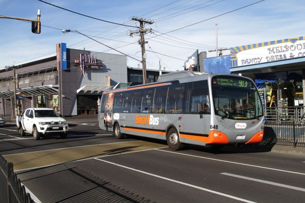 Transdev bus #648 7271AO on a route 903 service departs Essendon station