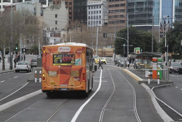 Transdev bus #414 rego 5914AO heads along the combined bus and tram lane on Queensbridge Street