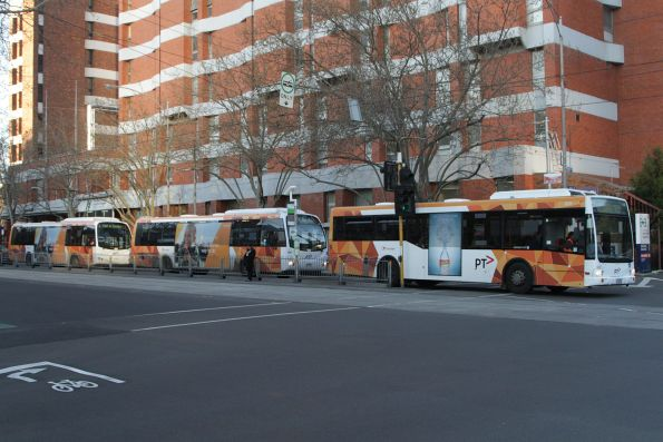 Trio of Transdev buses wait to turn from Gisborne Street into Albert Street