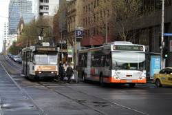 Transdev bus #719 rego 1719AO and tram A1.239 at La Trobe and Exhibition Street