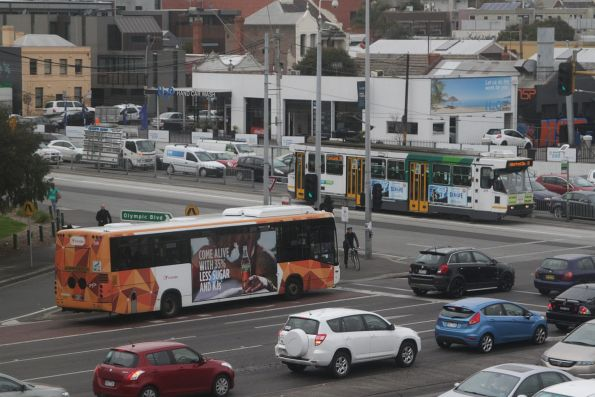 Transdev bus #529 on route 246 bus tram cross paths with a route 70 tram at Swan Street and Punt Road