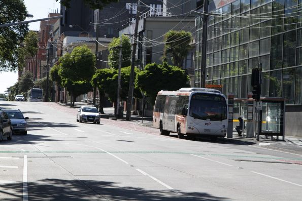 Transdev bus #617 7240AO heads east with a route 305 service along Victoria Parade