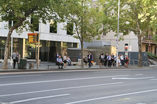 Bus passengers waiting at Lonsdale and William Street