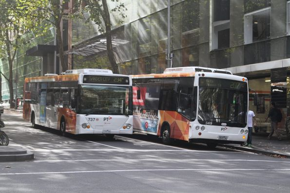Transdev #737 1737AO on route 234 and #549 5845AO on route 207 at Queen Street and Flinders Lane