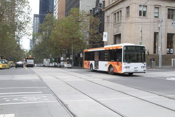 Transdev #367 0367AO on a route 235 service eastbound at Collins and William Street