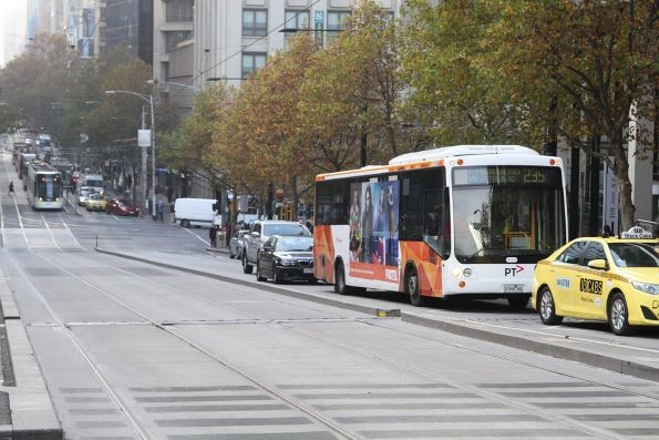 Transdev bus 0184AO on route 235 stuck in Collins Street traffic outside Southern Cross Station