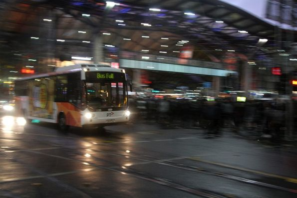 Transdev bus eastbound on Collins Street passes Southern Cross Station