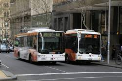 CDC Melbourne bus #122 7510AO passes Transdev bus #535 5831AO on route 350 at Queen and Collins Street
