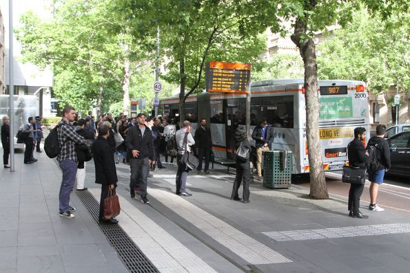 Big crowd of passengers waiting for buses on Lonsdale Street, due to the Burnley Group being replaced by buses as far as Camberwell