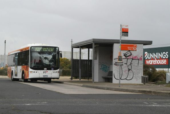 Transdev bus 9038AO waits at the Altona North park and ride with a route 232 service