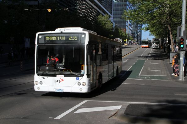 Transdev bus #744 1744AO heads east on route 235 at Collins and Spencer Street