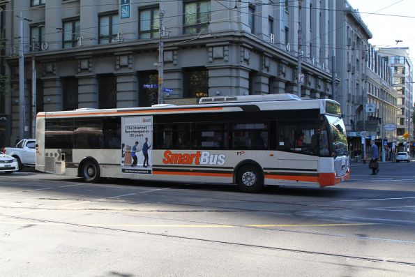 Smartbus liveried Transdev bus heads west on route 235 at Collins and Spencer Street