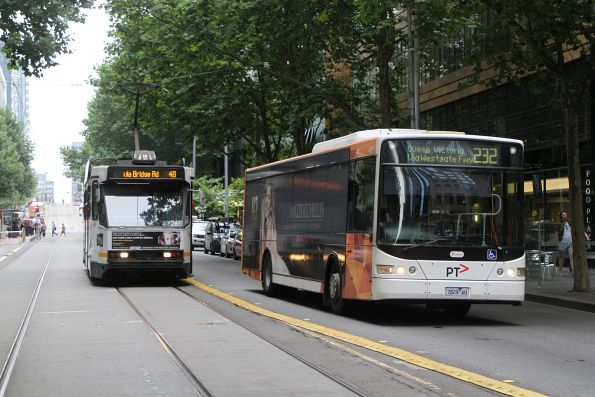 Transdev bus #429 7829AO on route 232 passes tram A2.269 on route 48 at Collins and King Street