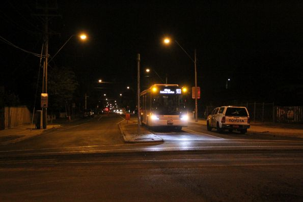 Transdev bus 9041AO on route 219 heads past roadwork on Wright Street, Sunshine