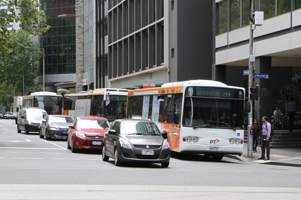 Transdev bus #379 4083AO on route 219 leads a queue of southbound buses at Queen and Bourke Street
