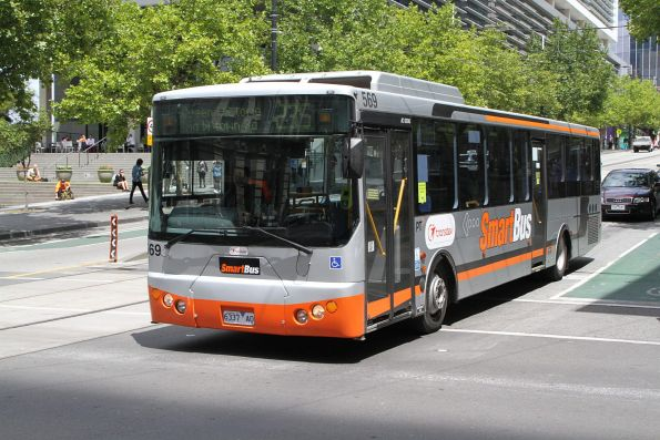 Transdev bus #569 6337AO heads east on route 235 at Collins and Spencer Street
