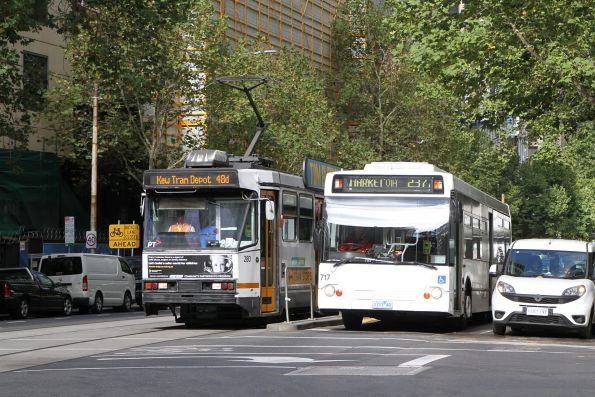Plain white liveried Transdev bus #717 1717AO on route 237 at Collins and William Street