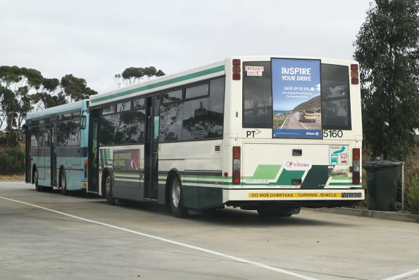 Ex-Transdev buses #5160 and #323 stored at the Calder Freeway truck stop at Calder Park